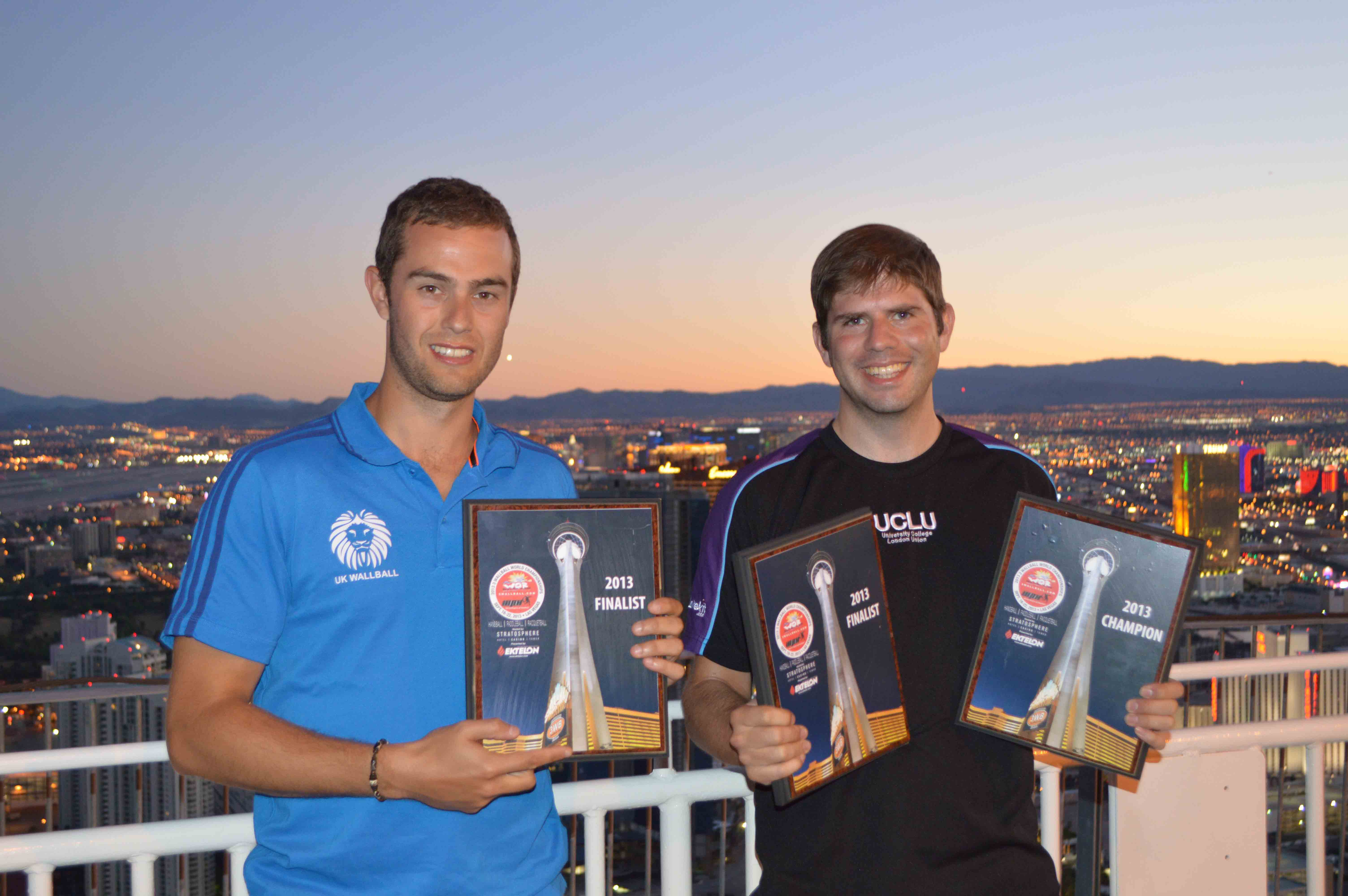 A tired looking Dan & Luke with their plaques on a sunset over the strip Sunday night.