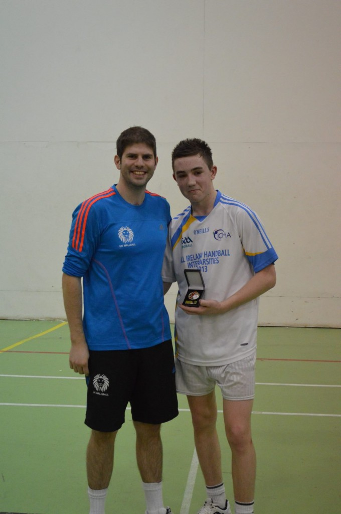 Daniel Kavanagh - twice a success story this weekend, receives his medal from UK Wallball President, Daniel Grant