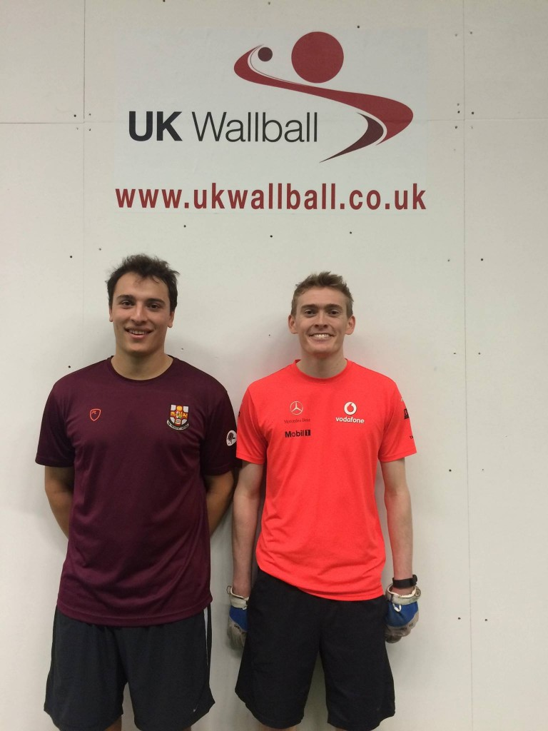 Ed on the right, flaring his nostrils at his first wallball victory, over Theo Parker